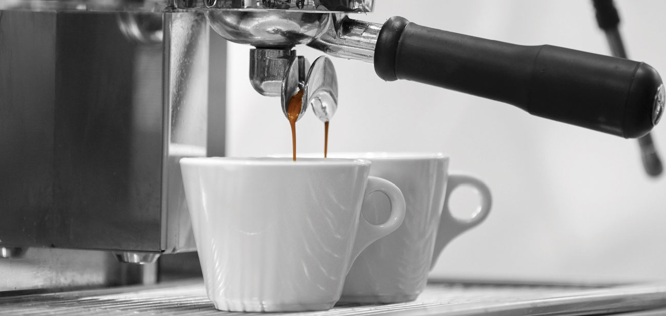 Image of a expresso machine making coffee